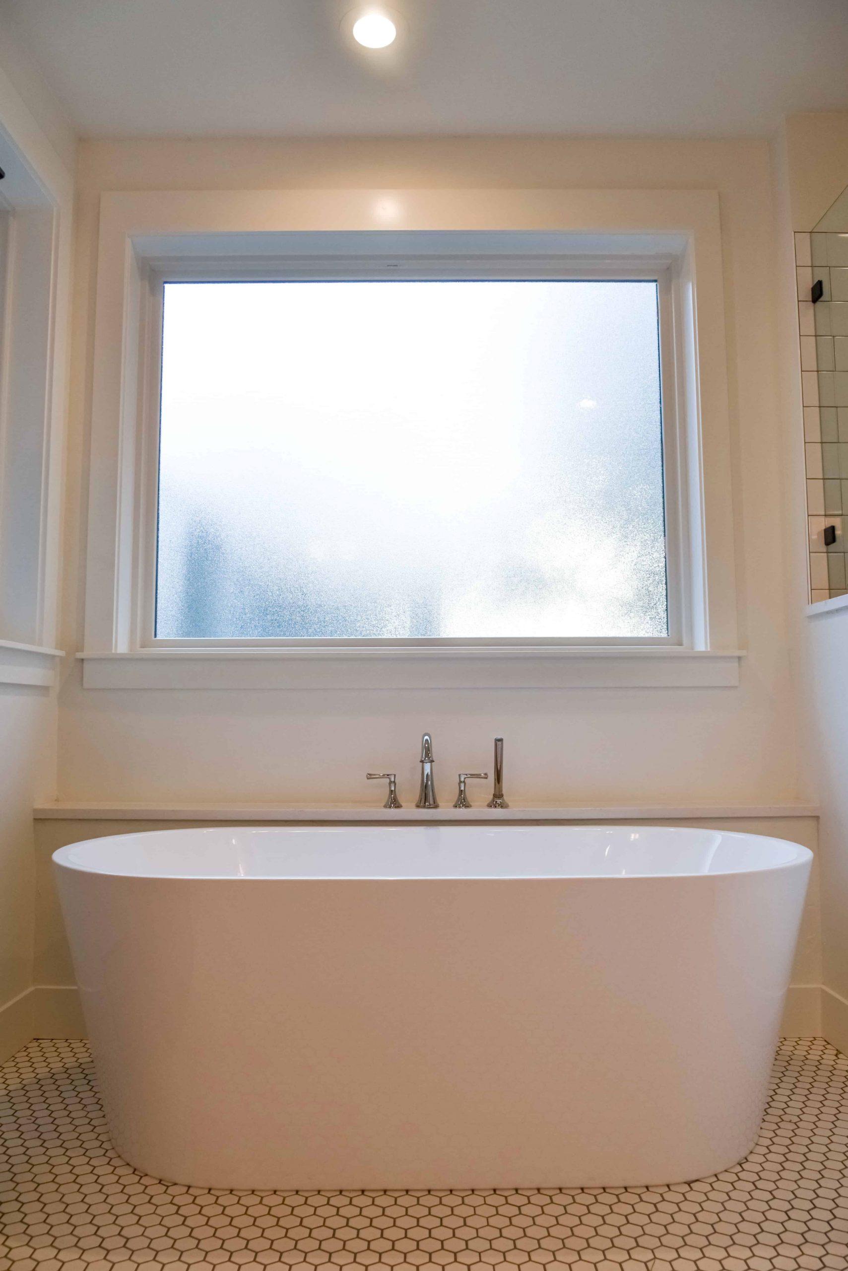 bathtub under window in custom home